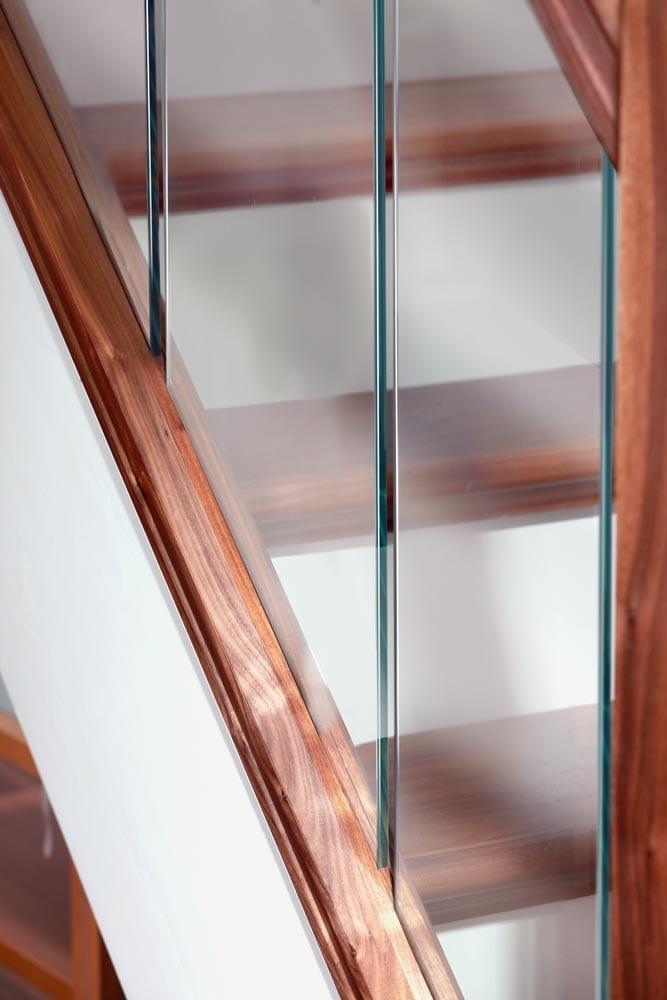 Glass Staircase design - Urbana Glass Panels Rake - George Quinn Stair Parts